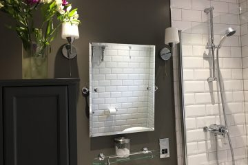 dark grey wall, white metro bathroom tiles, wall lights