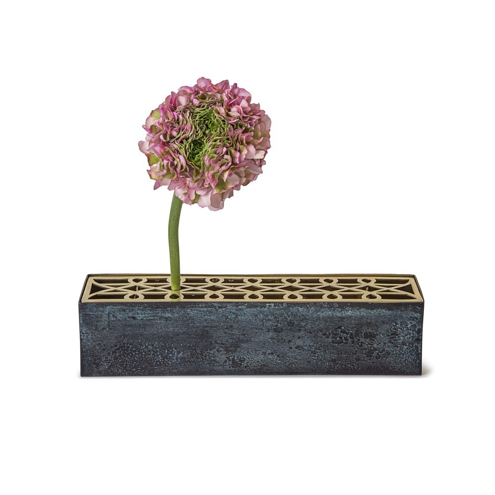 Blue concrete vase with pink flower