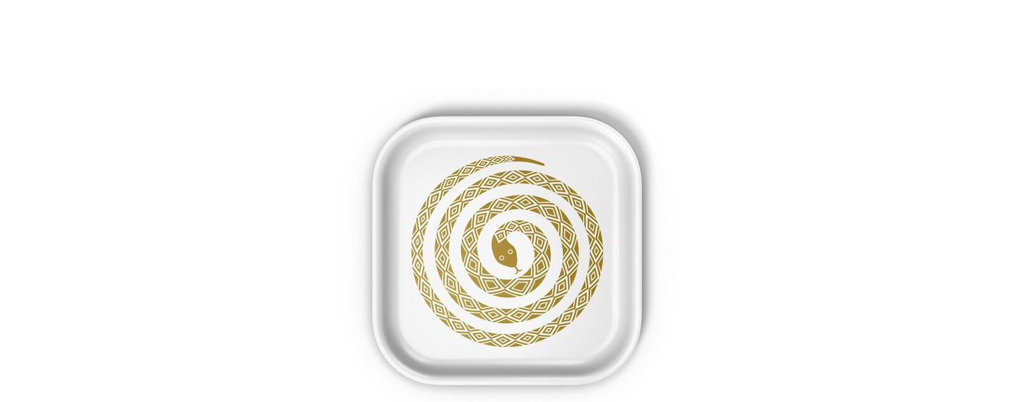 white classic tray  with gold snake figure in the middle