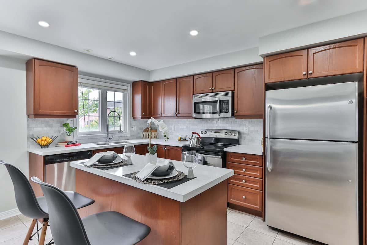 The L-shaped kitchen interior with island.