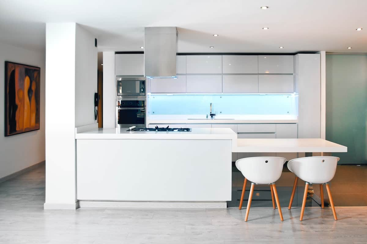 Single galley kitchen with island and dining.