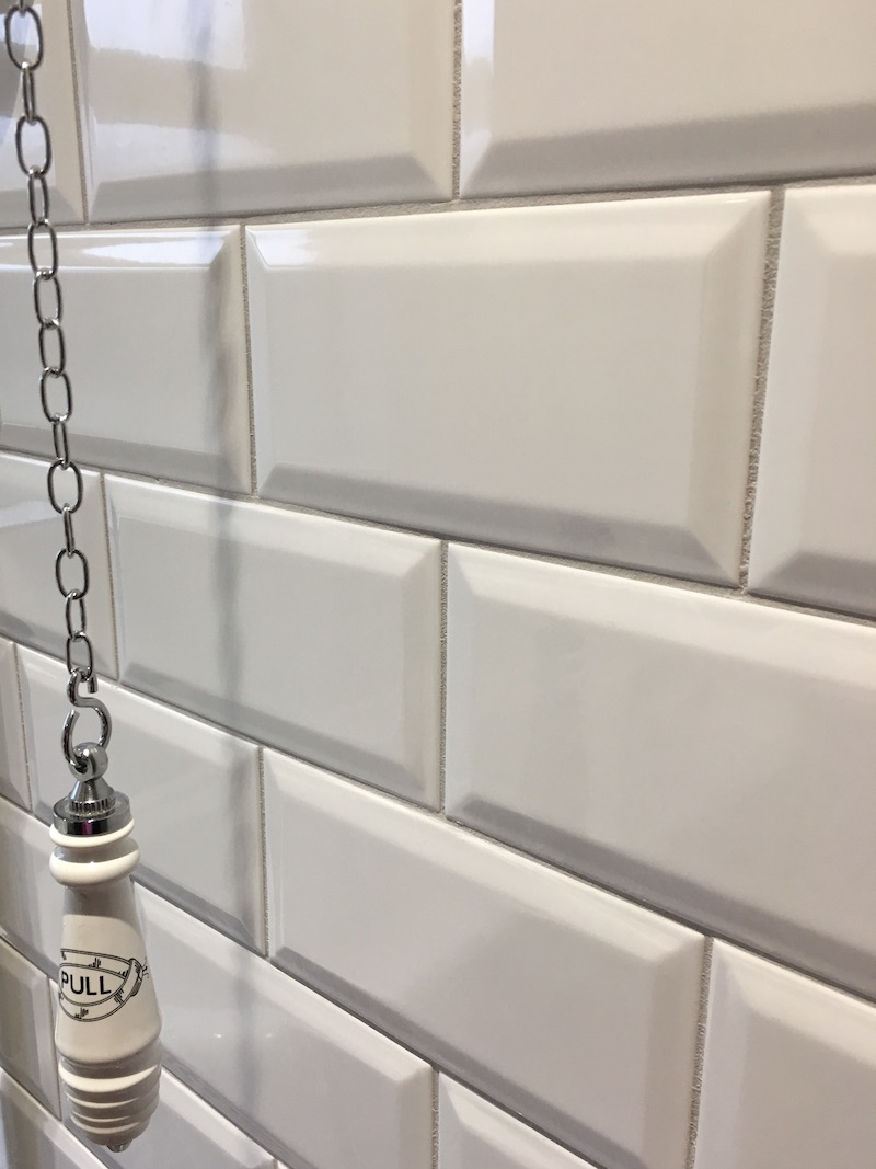 Detail from metro wall tiles and grout.